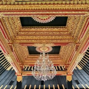 The luxuriously ornate roof at the Golden Hall inside the Kraton Place.