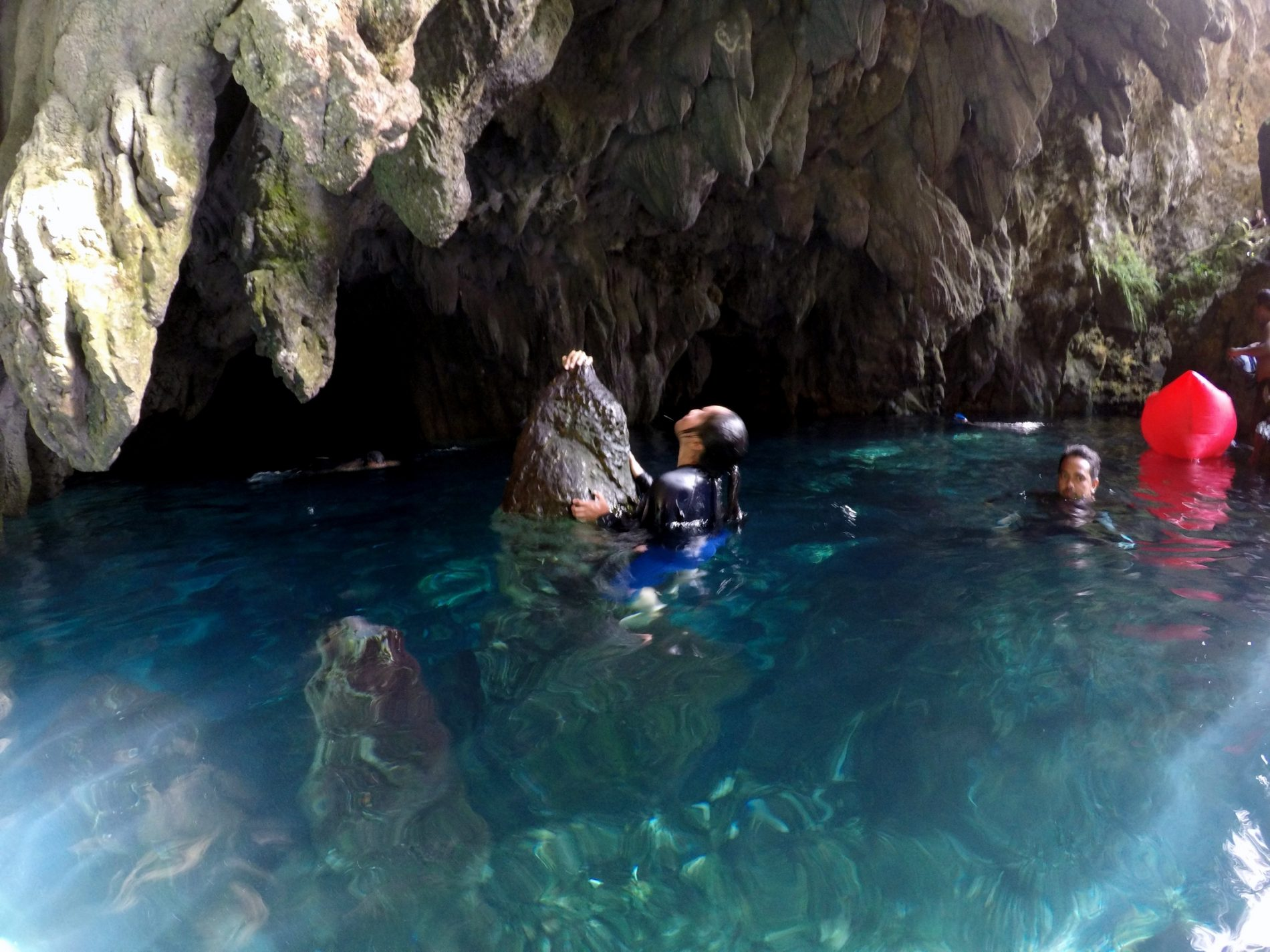 Glistening waters in the natural pool of Goa Hwang