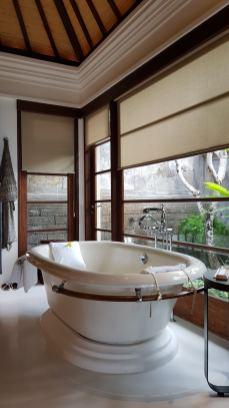 Ceramic bathtub in the bathroom
