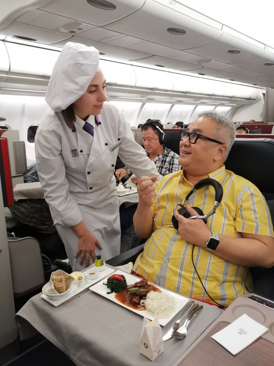 Dato' Chef Ismail on plane in Business Class with Flying Chef