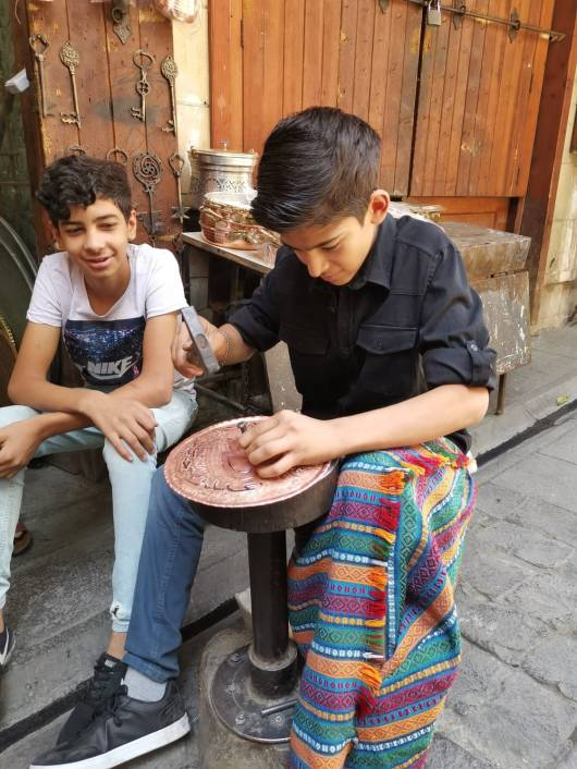 Young coppersmith at work at Coppersmith Bazaar