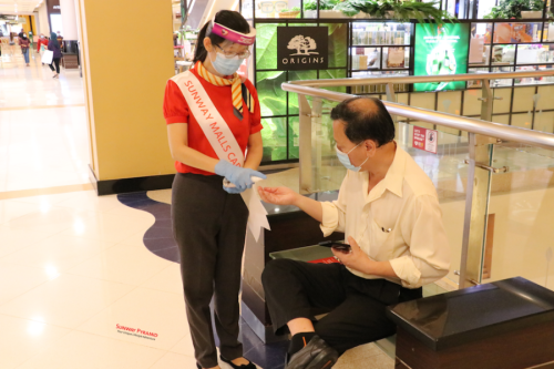 Social distancing officer enforcing social distance and hygiene practices at Sunway Pyramid copy