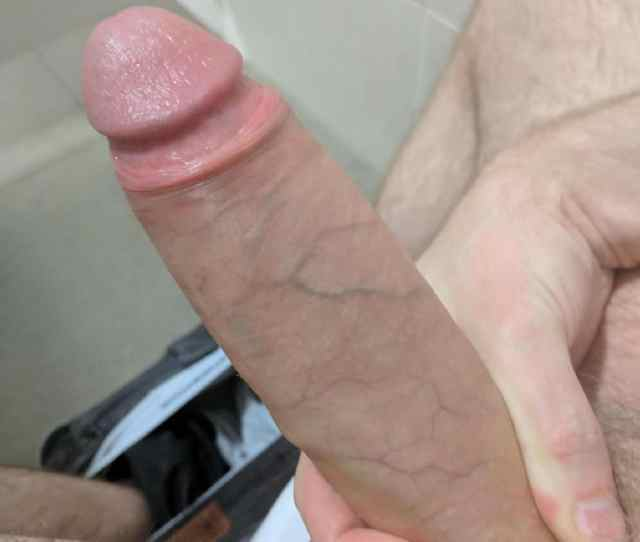 Horny Guy Sitting On The Toilet With His Jeans Dropped Down Taking A Closeup Picture Of His Big Hard Cock