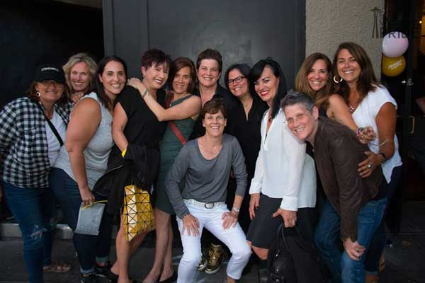 a group of women celebrating women's pride