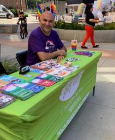 staff at gay city table with brochures