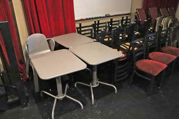 Photo of small gray metal tables and gray metal chairs