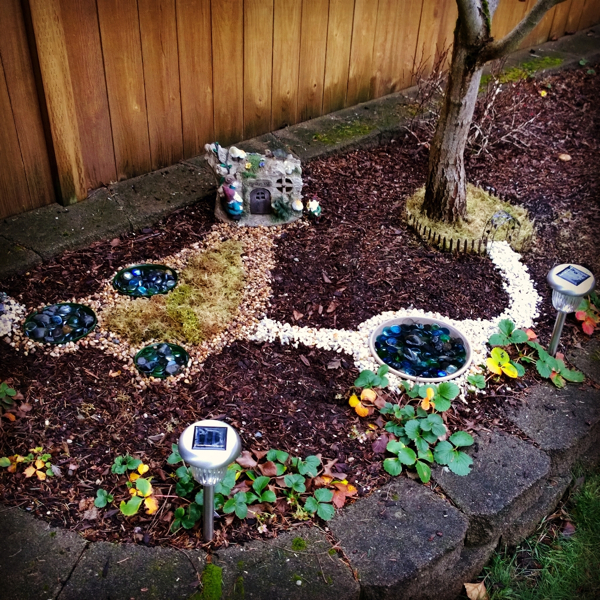 walker saw a fairy garden kit and asked for it it came with a tiny metal fence to go around a tree with an arbor bird bath gnome garden starter - Gnome Garden