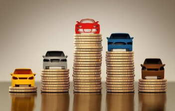Colored car silhouettes standing on gold coin stacks. 3D illustration