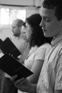 How do we assess singing and hymn books?