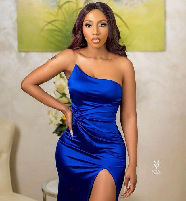 Mercy Eke in blue slit dress
