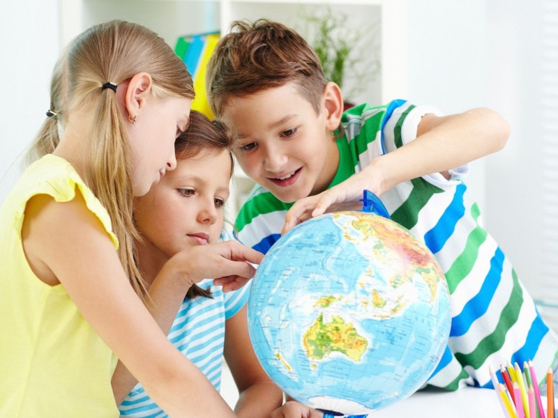Kids studying the globe