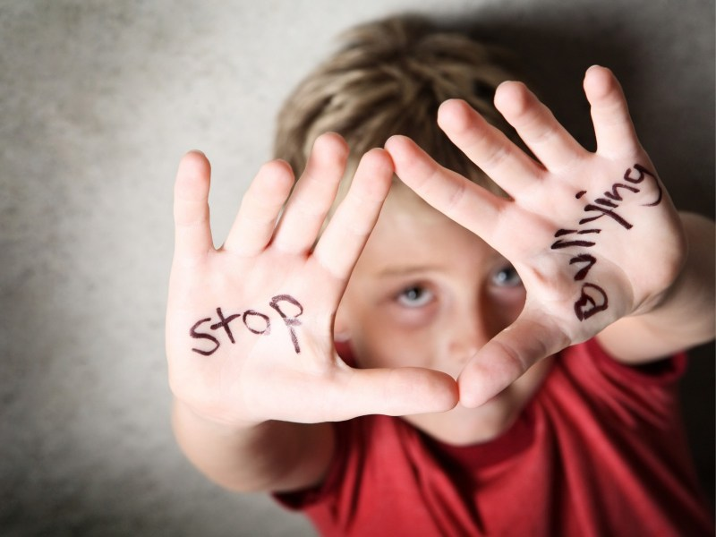 Boy with stop bullying written on hands