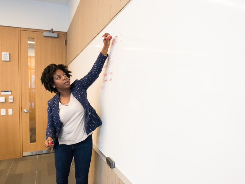 Teacher writing on the board