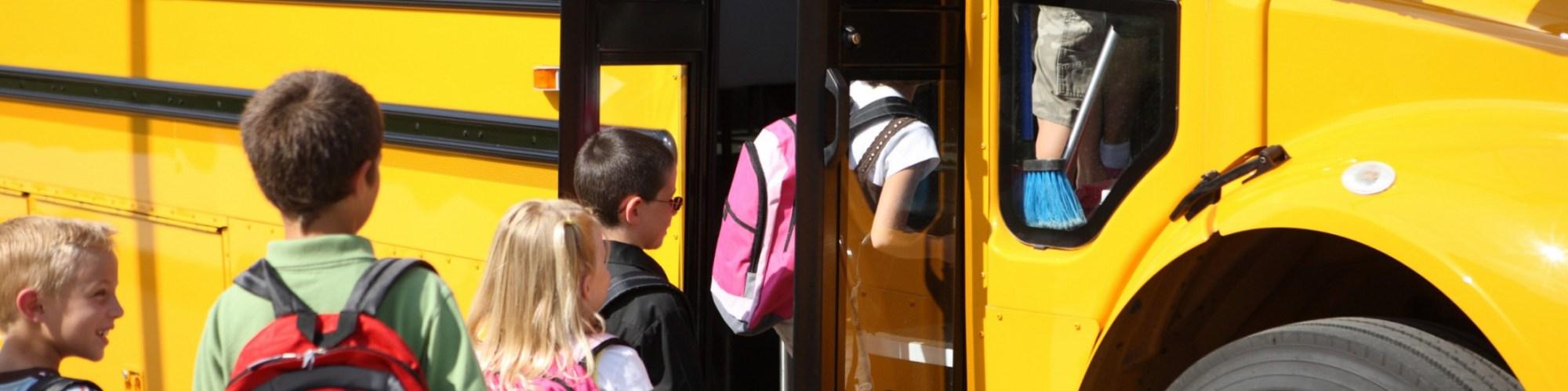 Kids getting on the school bus