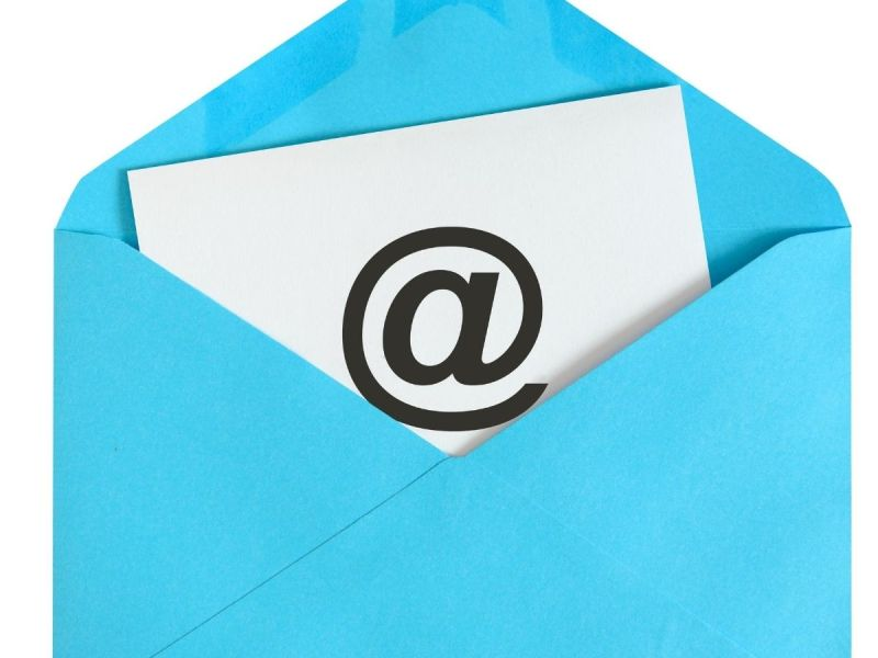 Photo of envelope with letter with @ written on it.