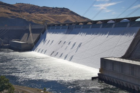 With a little less than 1.4 million gallons per second flowing out of Lake Roosevelt and down the Columbia River Tuesday morning, about 75,000 gallons per second were spilling over the top.