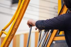 construction worker controls of lifting crane