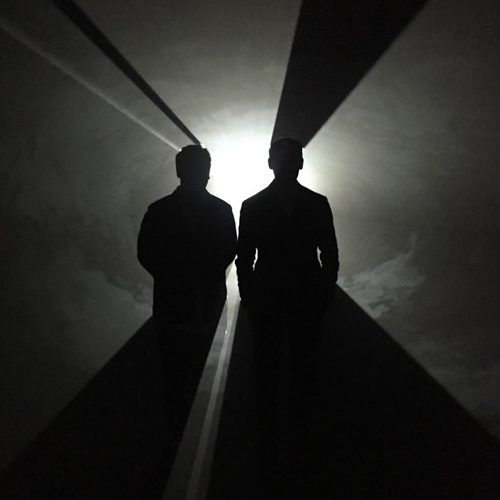 Sebastien Montabonel and Nicolas Cattelain in front of Solid Light by Anthony McCall, Photo by Dan Holdsworth