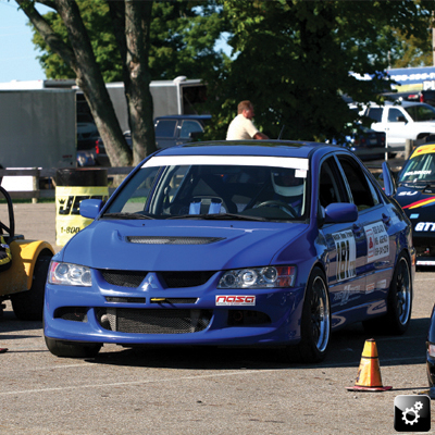 blue Mitsubishi Evo VIII staged 1
