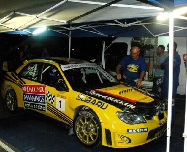 yellow subaru rally car