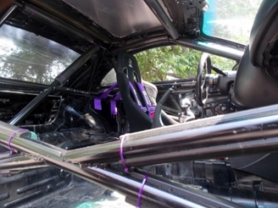 A look inside reveals this 3G is strictly business. Stripped. Caged. Race car.