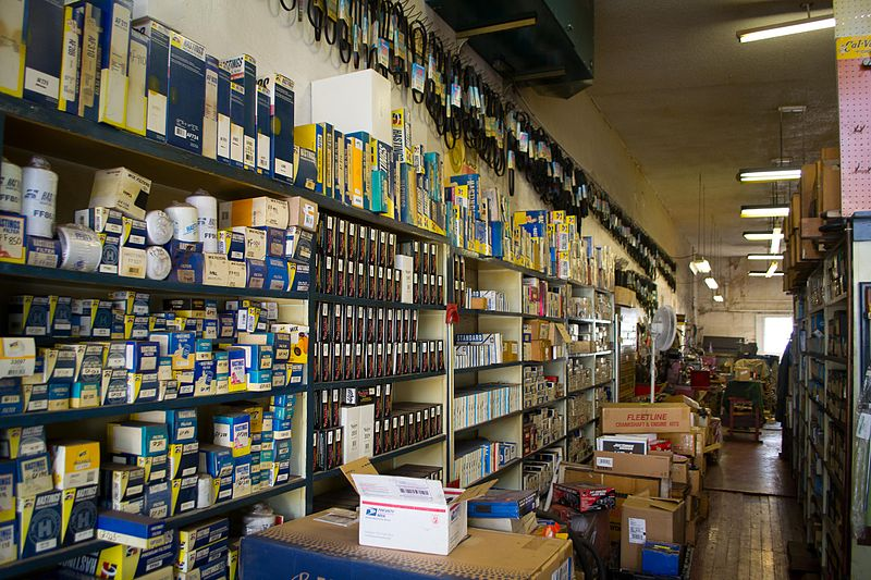 a look down the aisle at one of CarPartKings' warehouses