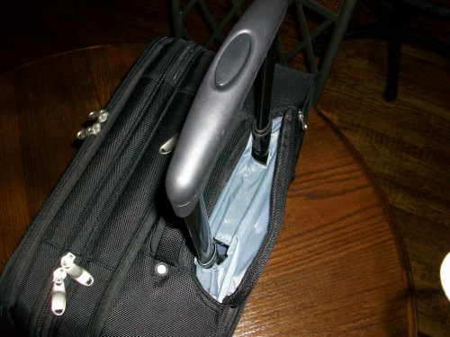 Handle of the Skooba Checkthrough Roller Bag