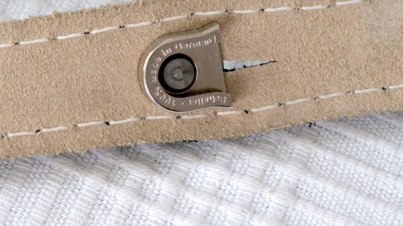 The bolt locks on to the strap pin for a secure fit