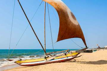 Boat on Negombo beach Sri Lanka