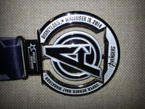 The race medal awarded to over 10,000 finishers from the first annual Avengers Half Marathon race at Disneyland.