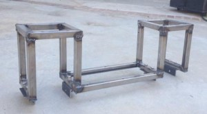 "The welded ""Halfway"" frame with angle brackets bolted on the bottom for mounting the axles."