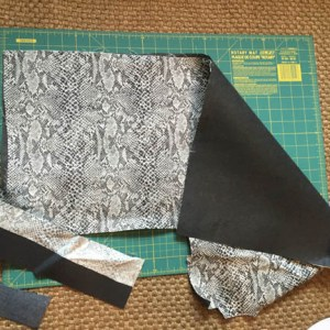 Use an iron-on fusible backing to stiffen the accent fabric if it is thin,