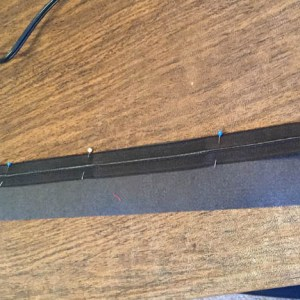 Pin zipper to thin lining strip and sew right sides together with the zipper foot.