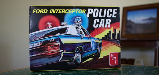 "The box for AMT's ""Ford Intercepter Police Car"" model kit."