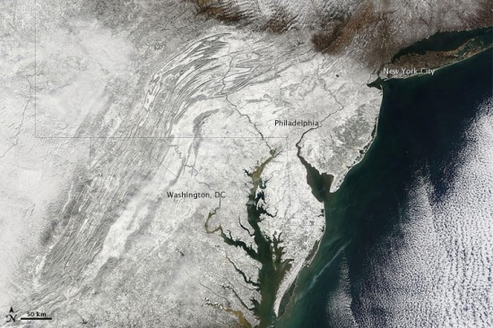 The NASA Earth Observatory has taken true-color satellite photos of Snowmageddon, everyone's favorite Beltway-crippling massive weekend snowstorm.
