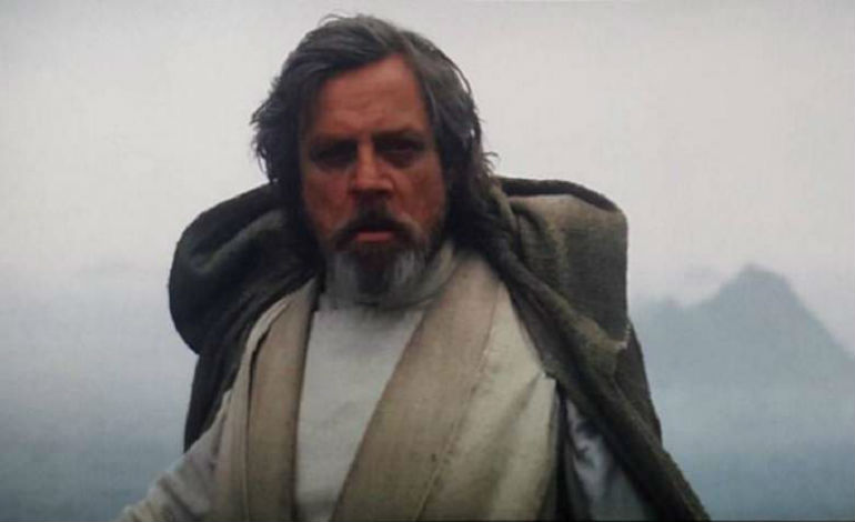 Luke having memories about the good old days with his lightsaber: getting shot by training remotes, barely being able to summon the lightsaber to him in the Wampa's cave, his own father cutting off his hand, not to mention the lightsaber ending the lives of children by his father's hand. Ah, those were the days.