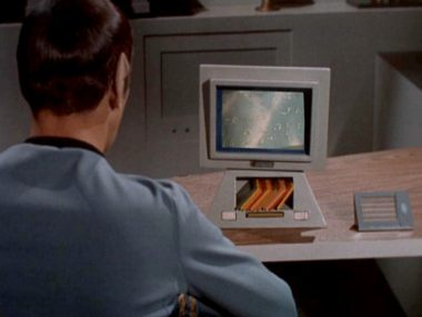 Spock at desktop terminal Memory Cards seen under the monitor