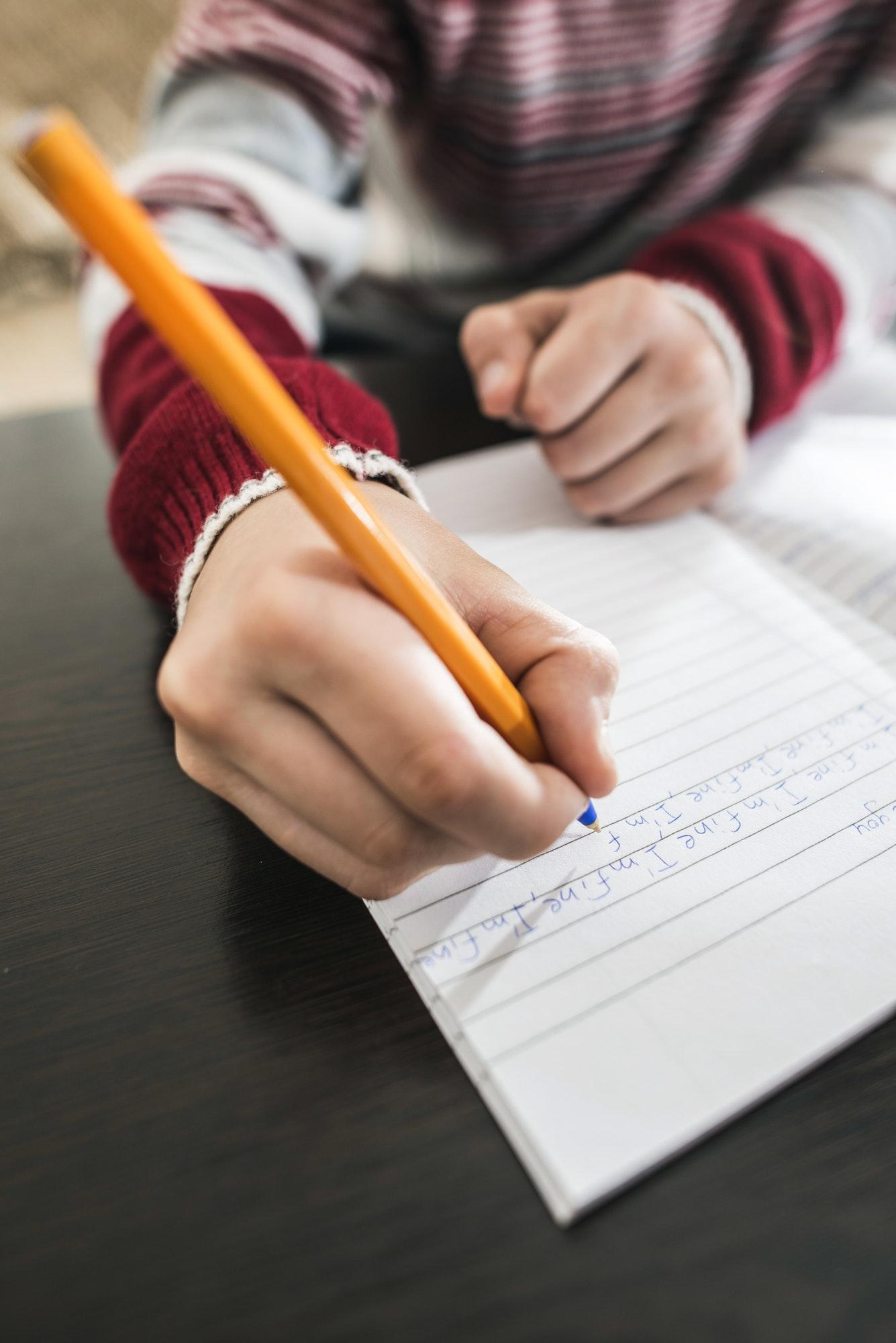 Child write in a notebook.