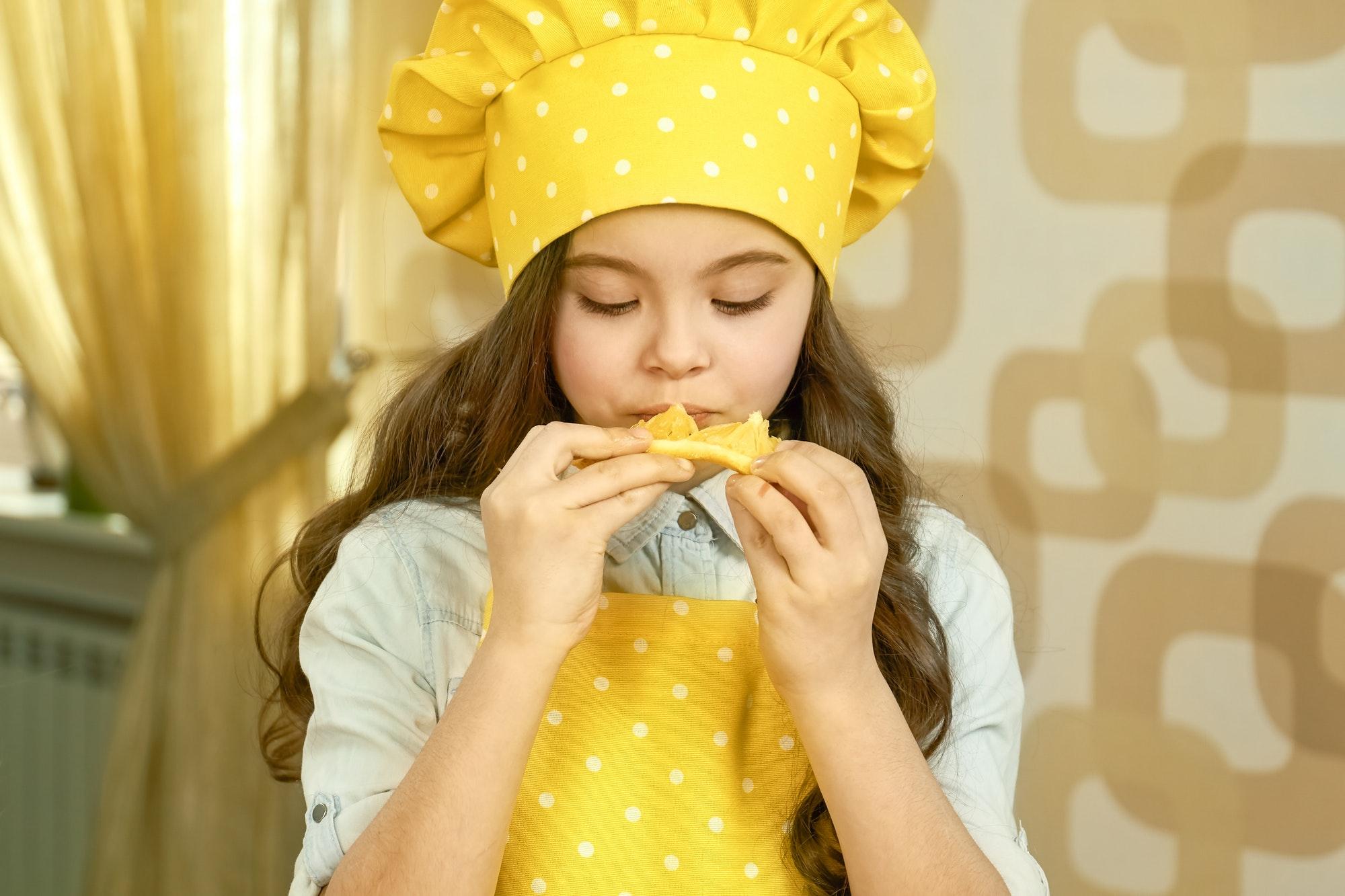 Child eating orange