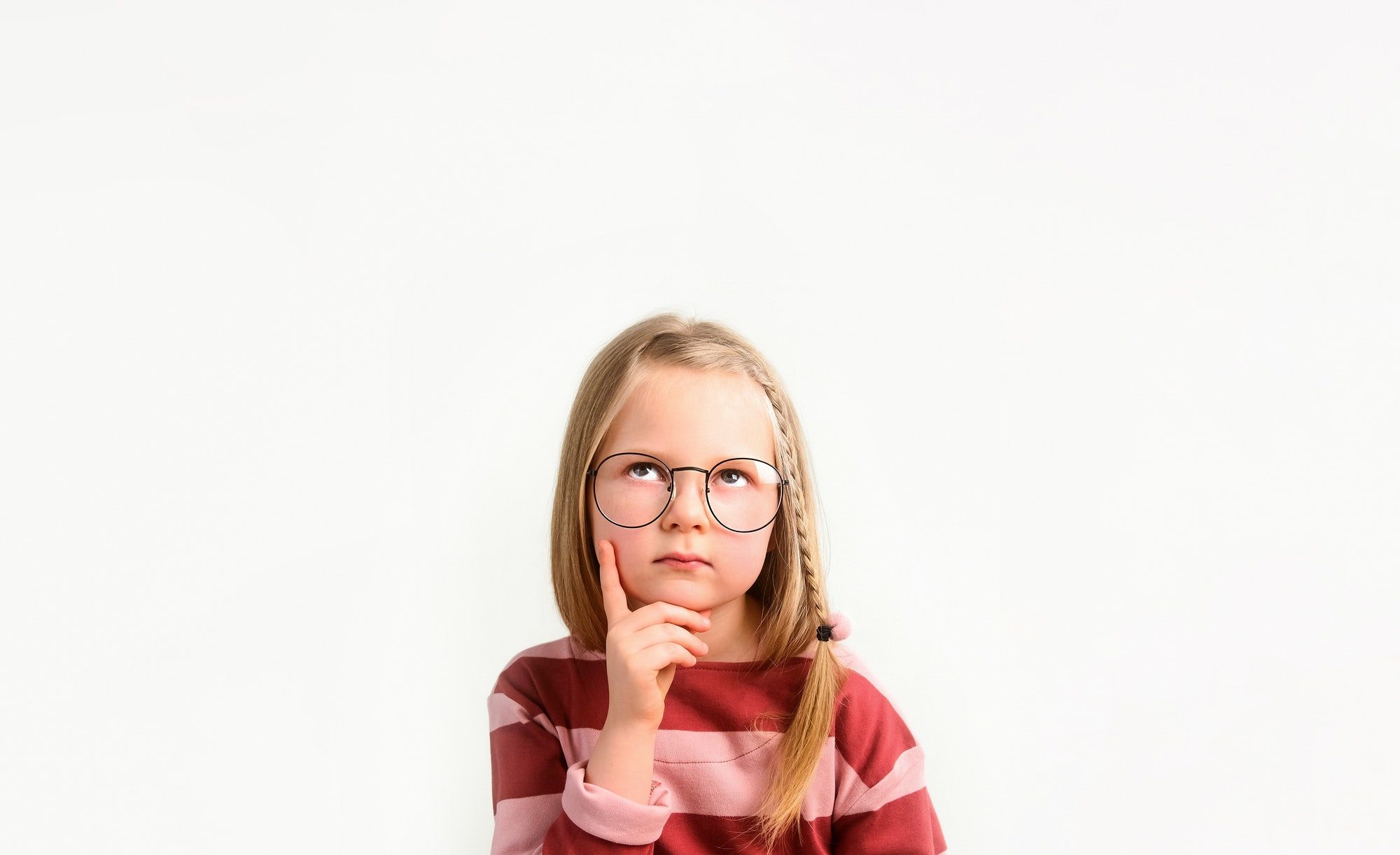 Little girl child thinking. Ponder and make a decision. Pensive and puzzled.