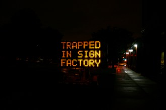 """Hacked traffic sign on MIT campus: """"Trapped on Sign Factory - Send Help"""""""