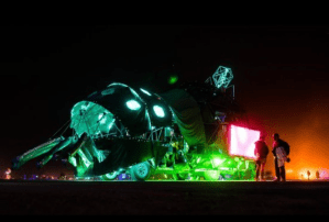 Bright lights illuminate a vehicle at Burning Man 2013