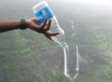 Nicely done - empty water bottle held just right looks like waterfall pouring from it