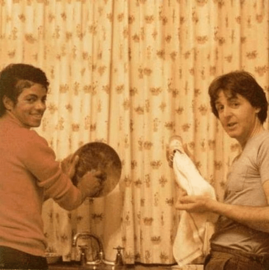 Michael Jackson and Paul McCartney doing dishes.