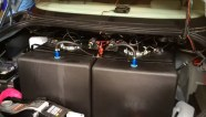 Dual 22-gallon tanks installed inside the Mercedes' trunk