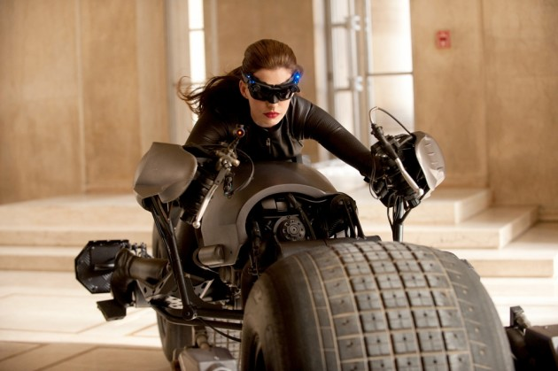 Anne Hathaway as Catwoman riding the Batpod