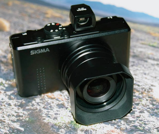 The Sigma DP-1 with optical finder and lens hood attached