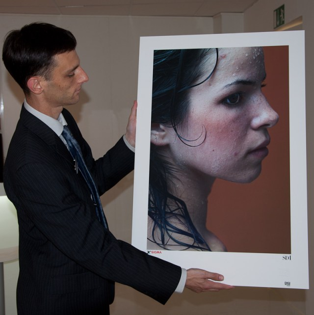 Sigma's Paul Reynolds displaying a print from the SD1