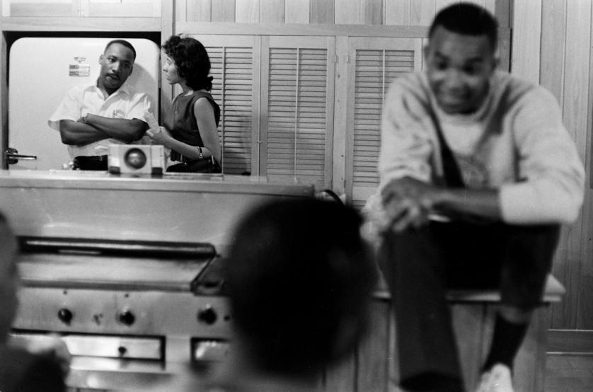 The Freedom Riders: The Reverend Dr. Martin Luther King Jr. looks tense, perhaps worried, in the kitchen of a safe house. As a volunteer bends his ear, the 32-year-old civil rights leader glances toward one of the 17 students hunkered down with him.