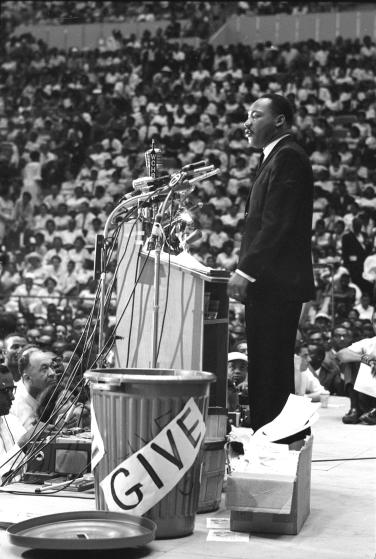 Reverend Martin Luther King Jr. (R) addressing rally. (Photo by Francis Miller/The LIFE Picture Collection/Getty Images)